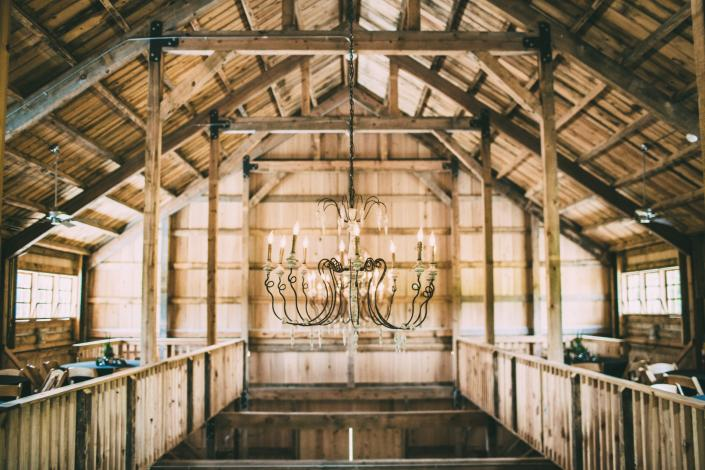 Our rustic barn has gorgeous details, the chandeliers are a favorite detail to most of our customers. ]